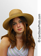 Girl with a straw hat.