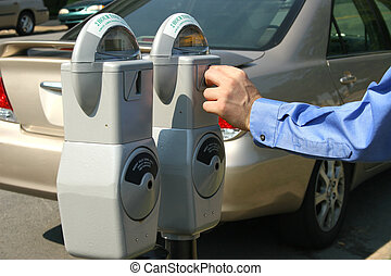 Money in Parking Meter - Adult male hand putting money in a...