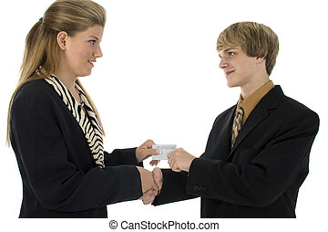 Credit Card - Two teens in suits exchanging hand shake and...