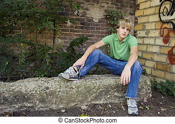 Attractive Teen Boy - Cute 15 year old boy sitting outside...