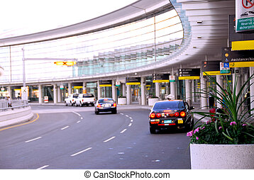 Terminal - Airport terminal with cars outside