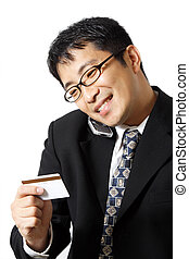 Shopping businessman - A businessman talking on the phone...