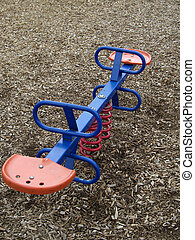 Teeter Totter - teeter totter on a childrens playground