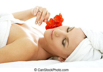 spa relaxation 2 - beautiful lady with red flower in spa...