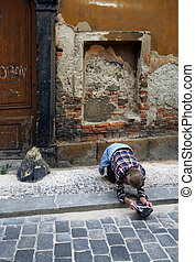 Poverty in Prague - A homeless man begging for pocket change...