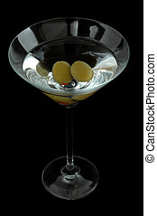 Martini with green olives isolated on a black background