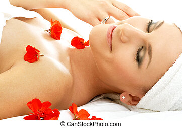 red petals spa 4 - beautiful lady with red flowers in spa