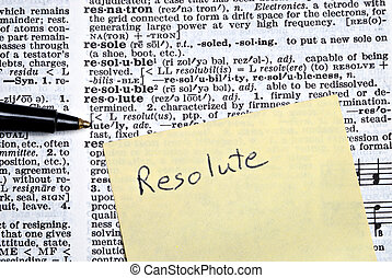 Resolute written on sticky note on top of dictionary page...