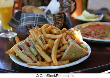 Clubsandwich with fries - Plate of clubsandwich filled up...