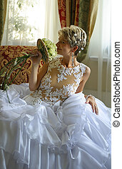 Beautiful bride - The beautiful bride with a bouquet in an...