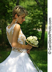 Beautiful bride - The beautiful bride in park with a wedding...