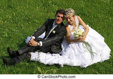 Newly-married couple - Beautiful newly-married couple sit on...