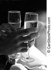 Champagne - Glass of champagne in a hand of the groom and...