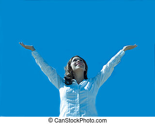 Expression of joy. - A hispanic woman with arms extended to...