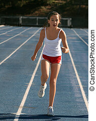 Girl exercising on a blue racetrack