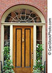 Door Number Sixteen Boston - Natural woodgrain door with...