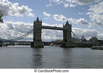 London Bridge With Clouds - London Bridge silhouetted in...