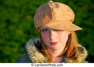 Girl winter hat - Portriat of a young smiling girl in winter...