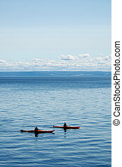 Two Kayaks - couple kayaking on the sea