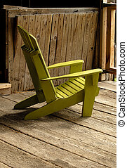 Adirondack Chair - A Painted Wooden Muskoka Chair In A Barn