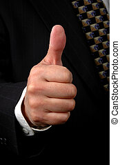 Thumbs Up - Hand of businessman showing the thumbs up symbol