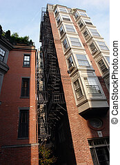 Tall building with fire escape and bay windows full color -...