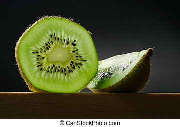 still life with kiwi fruit - still life with slice and...