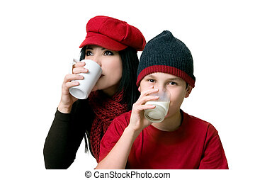 Two people drinking beverages - An adult sipping coffee and...