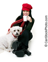 Woman relaxing with a small pet dog - A female adult relaxes...