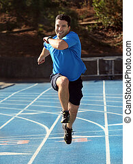 Man running on a blue racetrack