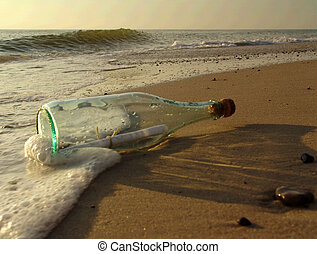 message in a bottle - taken on a sandy beach in denmark,...