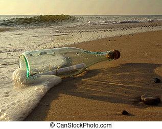 message in a bottle - taken on a sandy beach in denmark,...