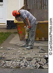 men at work - A worker using a jackhammer