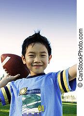 Sporty boy - A boy throwing a football