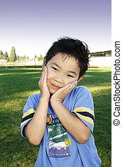 Cute boy - A cute boy posing outdoor