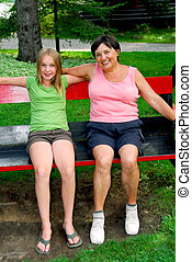 Family on swings - Grandmother and granddaughter on swings