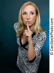 Silence or Secrecy - A female gestures for silence or...
