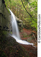 Waterfall side view - A side view of a small waterfall in...