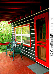 Log cabin deck - Deck of a  log cottage in pine forest