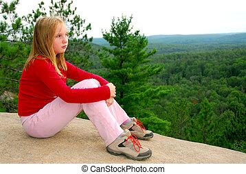 Girl edge cliff