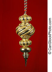 Christmas Ornament - Golden Christmas ornament over red...