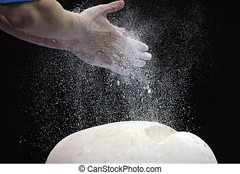 Preparation - Close-up of hands of the gymnast in talc