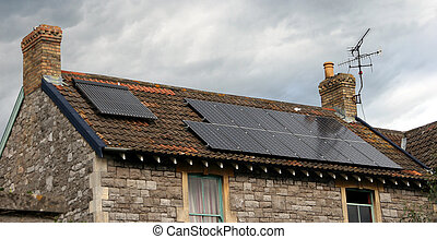 Solar panel - solar panels on a stone cottage