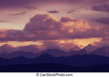 Purple Dusk - Sunset through the gathering clouds over the...