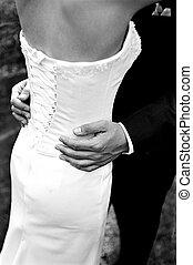 Bride & groomBride & groom - Detail shot of bride\\\'s dress...