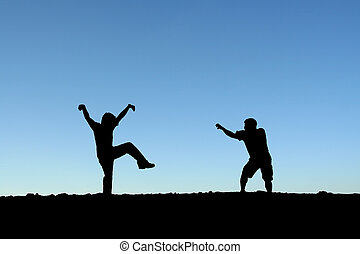Martial arts - Two men practicing martial arts on top of a...