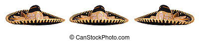 The three amigos - Three black and gold sombreros isolated...