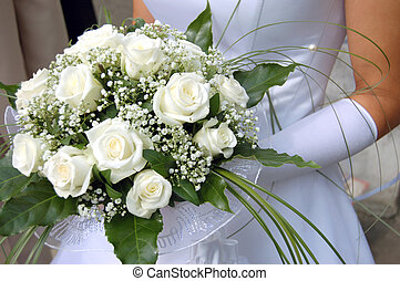 Brides bouquet - A bride holds her bouquet of white roses...