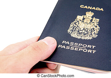 canadian passport - hand hold a isolated canadian passport