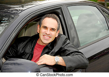 Man in car - Smiling man looking from a car window